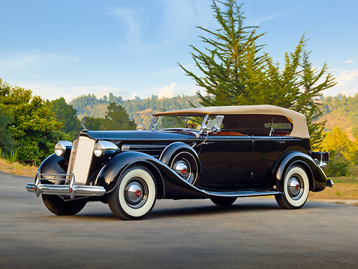 AUT 19 RK0971 01 © Kimball Stock 1937 Packard 1507 Sport Phaeton Black 3/4 Side View On Pavement By Trees
