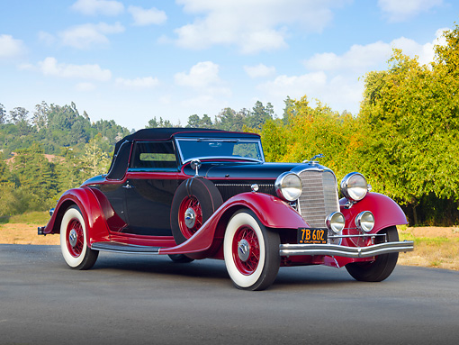 AUT 19 RK0978 01 © Kimball Stock 1933 Lincoln KB Lebaron Convertible Coupe Black And Red 3/4 Front View On Pavement By Trees