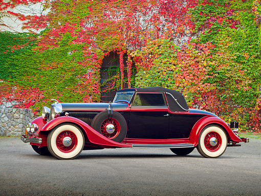 AUT 19 RK0982 01 © Kimball Stock 1933 Lincoln KB Lebaron Convertible Coupe Black And Red Profile View On Pavement By Ivy Covered Building