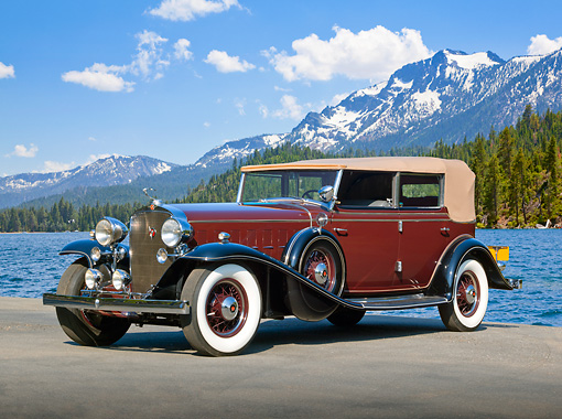 AUT 19 RK1002 01 © Kimball Stock 1932 Cadillac V16 Convertible Sedan Maroon And Black 3/4 Side View On Pavement By Lake And Mountains
