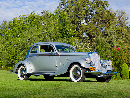 AUT 19 RK1003 01 © Kimball Stock 1934 Pierce Arrow Model 840A Silver Arrow Coupe Silver And Gunmetal 3/4 Front View On Grass By Trees