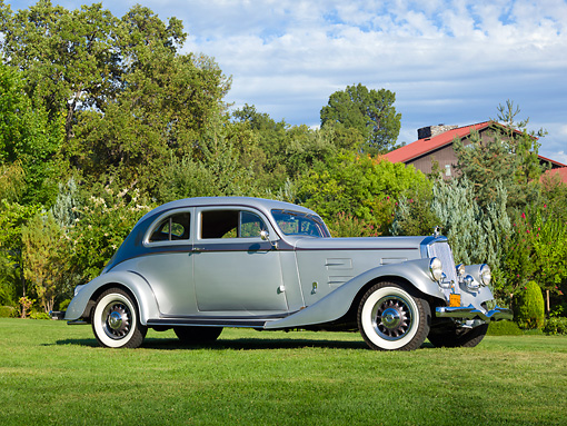 AUT 19 RK1004 01 © Kimball Stock 1934 Pierce Arrow Model 840A Silver Arrow Coupe Silver And Gunmetal 3/4 Side View On Grass By Trees