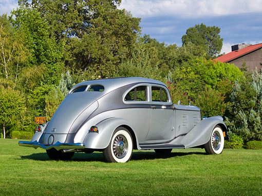 AUT 19 RK1005 01 © Kimball Stock 1934 Pierce Arrow Model 840A Silver Arrow Coupe Silver And Gunmetal 3/4 Rear View On Grass By Trees