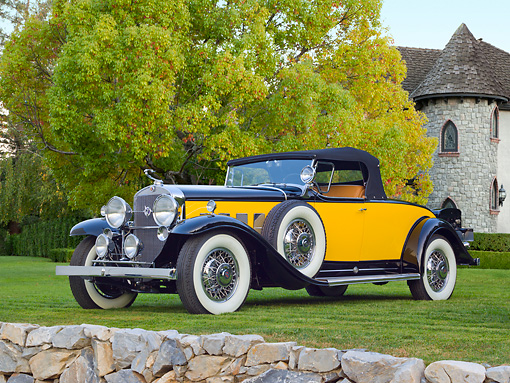 AUT 19 RK1012 01 © Kimball Stock 1931 Cadillac 370A Roadster Yellow And Black 3/4 Front View On Grass By Trees And House