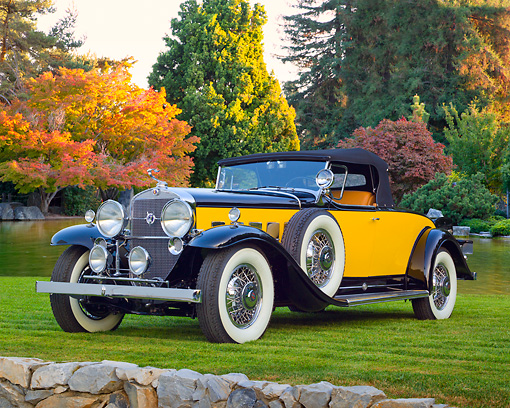 AUT 19 RK1013 01 © Kimball Stock 1931 Cadillac 370A Roadster Yellow And Black 3/4 Front View On Grass By Autumn Trees And Pond