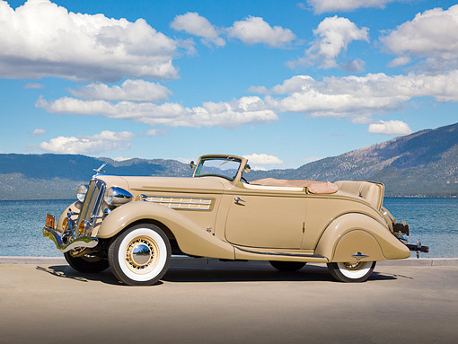 AUT 19 RK1020 01 © Kimball Stock 1935 Hudson Convertible Pepper Tan Profile View On Pavement By Water
