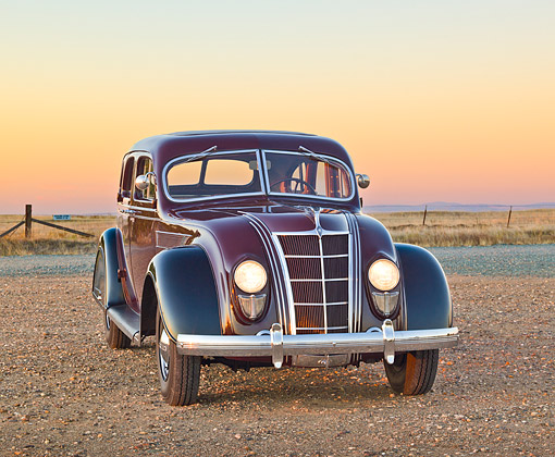 AUT 19 RK1023 01 © Kimball Stock 1935 Chrysler C2 Airflow Imperial Maroon And Black 3/4 Front View On Gravel At Dusk