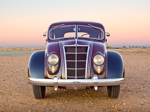 AUT 19 RK1024 01 © Kimball Stock 1935 Chrysler C2 Airflow Imperial Maroon And Black Front View On Gravel At Dusk