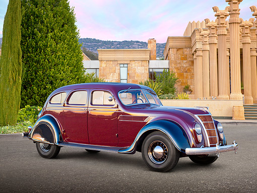 AUT 19 RK1025 01 © Kimball Stock 1935 Chrysler C2 Airflow Imperial Maroon And Black 3/4 Side View On Pavement By Building With Pillars