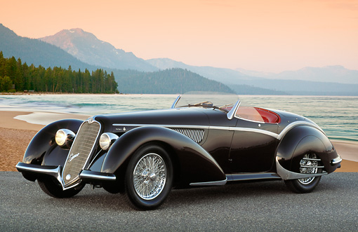 AUT 19 RK1029 01 © Kimball Stock 1937 Alfa Romeo 8C 2900B Spider Black 3/4 Front View On Pavement By Beach At Dusk