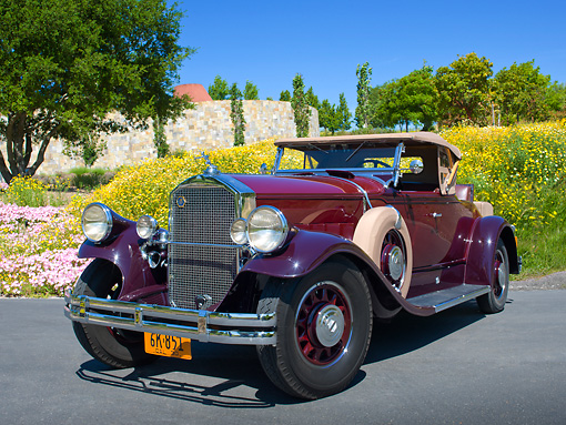 AUT 19 RK1031 01 © Kimball Stock 1930 Pierce-Arrow Model B Two-Tone Maroon 3/4 Front View On Pavement By Wildflowers