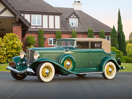AUT 19 RK1040 01 © Kimball Stock 1933 Auburn Salon 8-105 Mountain Green 3/4 Side View On Pavement By House