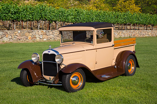 AUT 19 RK1042 01 © Kimball Stock 1931 Ford Model A Pickup Beige 3/4 Front View On Grass By Vineyard