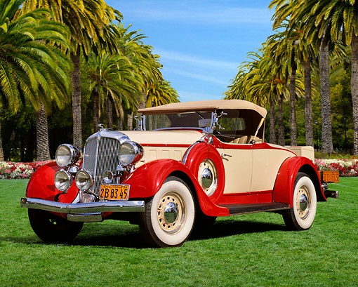 AUT 19 RK1044 01 © Kimball Stock 1934 Chrysler Roadster Red And Beige 3/4 Front View On Grass By Trees