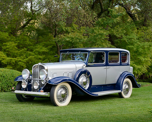 AUT 19 RK1047 01 © Kimball Stock 1931 Franklin Oxford Sedan Silver And Blue 3/4 Side View On Grass By Trees