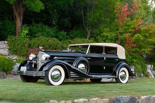 AUT 19 RK1050 01 © Kimball Stock 1933 Cadillac V-16 All Weather Phaeton Fleetwood Black 3/4 Side View On Grass By Trees