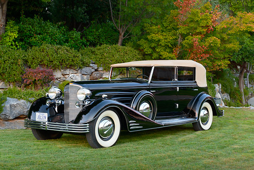 AUT 19 RK1051 01 © Kimball Stock 1933 Cadillac V-16 All Weather Phaeton Fleetwood Black 3/4 Front View On Grass By Trees