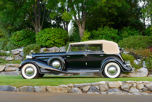 AUT 19 RK1052 01 © Kimball Stock 1933 Cadillac V-16 All Weather Phaeton Fleetwood Black Profile View On Grass By Trees
