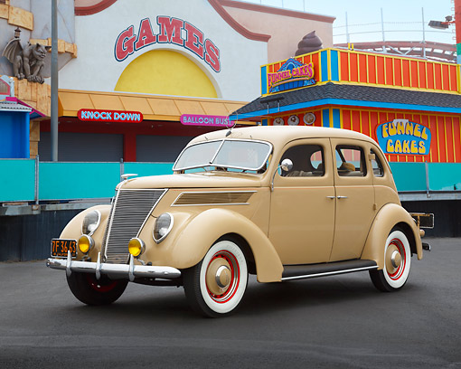 AUT 19 RK1056 01 © Kimball Stock 1937 Ford Deluxe Slantback 4 Door Adobe Tan 3/4 Front View On Pavement By Carnival Games