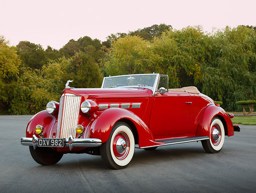 AUT 19 RK1057 01 © Kimball Stock 1937 Packard 120 Convertible Coupe Red 3/4 Front View On Pavement By Trees