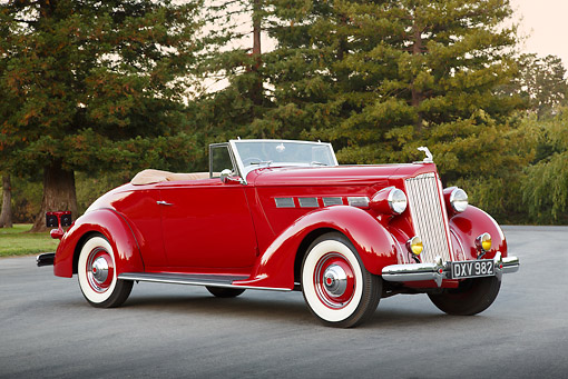 AUT 19 RK1059 01 © Kimball Stock 1937 Packard 120 Convertible Coupe Red 3/4 Side View On Pavement By Trees