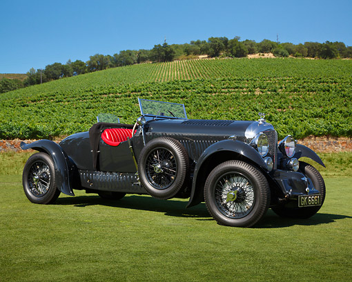 AUT 19 RK1061 01 © Kimball Stock 1930 Bentley 4 Black 3/4 Side View On Grass By Vineyard