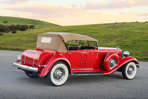 AUT 19 RK1065 01 © Kimball Stock 1933 Chrysler CL Red 3/4 Rear View On Pavement By Grassy Hills At Dusk