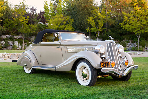 AUT 19 RK1066 01 © Kimball Stock 1935 Hudson Convertible Pepper Tan 3/4 Front View On Grass By Trees