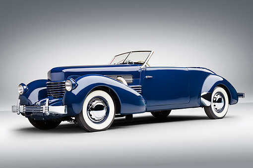 AUT 19 RK1080 01 © Kimball Stock 1937 Cord Supercharged 812 Phaeton Blue 3/4 Front View On White Seamless