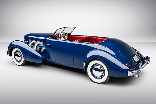 AUT 19 RK1081 01 © Kimball Stock 1937 Cord Supercharged 812 Phaeton Blue 3/4 Rear View On White Seamless