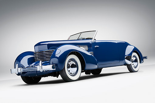 AUT 19 RK1082 01 © Kimball Stock 1937 Cord Supercharged 812 Phaeton Blue 3/4 Rear View On White Seamless