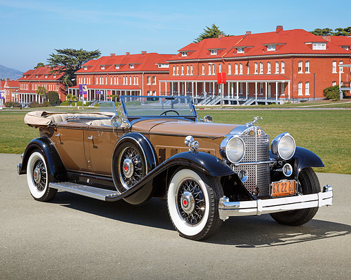 AUT 19 RK1084 01 © Kimball Stock 1932 Packard 903 Sport Phaeton Brown With Black Fenders 3/4 Front View On Gravel By Brick Buildings