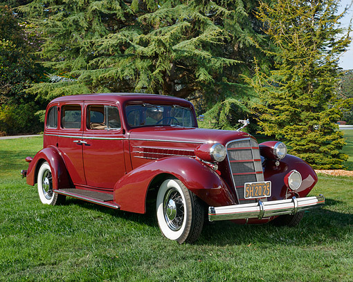 AUT 19 RK1090 01 © Kimball Stock 1935 Cadillac 355-D Series 10 Maroon 3/4 Front View On Grass By Trees
