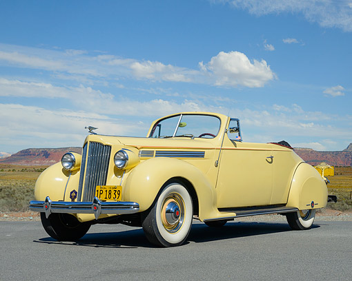 AUT 19 RK1092 01 © Kimball Stock 1938 Packard 120 Convertible Yellow 3/4 Front View On Pavement By Mountains