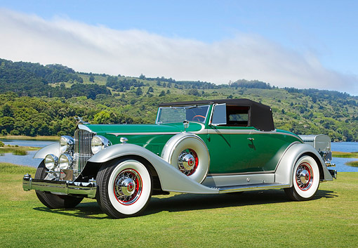 AUT 19 RK1093 01 © Kimball Stock 1933 Packard Green 3/4 Front View On Grass By Water And Hills