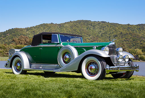 AUT 19 RK1094 01 © Kimball Stock 1933 Packard Green 3/4 Front View On Grass By Water And Hills