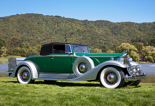 AUT 19 RK1095 01 © Kimball Stock 1933 Packard Green 3/4 Front View On Grass By Water And Hills