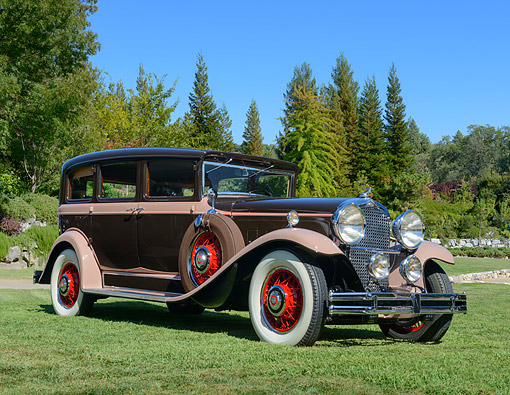 AUT 19 RK1099 01 © Kimball Stock 1930 Marmon Big 8 Chocolate And Taupe 3/4 Front View On Grass By Trees