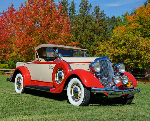 AUT 19 RK1100 01 © Kimball Stock 1934 Chrysler CA Champagne And Red 3/4 Front View On Grass By Autumn Trees