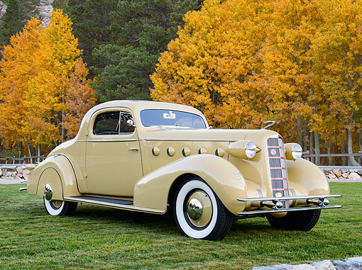 AUT 19 RK1102 01 © Kimball Stock 1934 La Salle 350 Series 2-Door Coupe Diana Cream 3/4 Front View On Grass By Autumn Trees