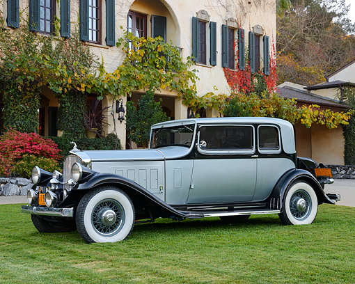 AUT 19 RK1111 01 © Kimball Stock 1932 Pierce-Arrow Model 54 Club Brougham Silver And Black 3/4 Side View On Grass By House