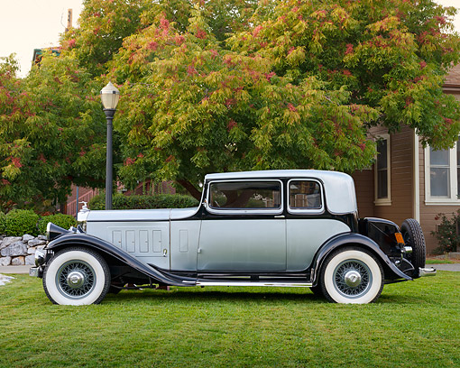 AUT 19 RK1112 01 © Kimball Stock 1932 Pierce-Arrow Model 54 Club Brougham Silver And Black Profile View On Grass By House
