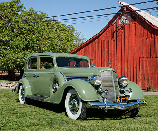AUT 19 RK1113 01 © Kimball Stock 1935 Buick Club Sedan Green 3/4 Front View On Grass By Red Barn