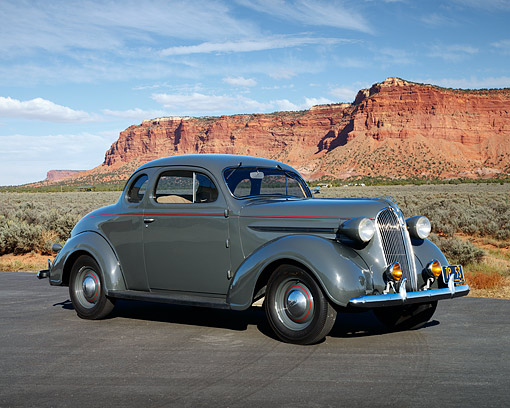 AUT 19 RK1119 01 © Kimball Stock 1938 Plymouth Gray 3/4 Side View On Pavement In Desert