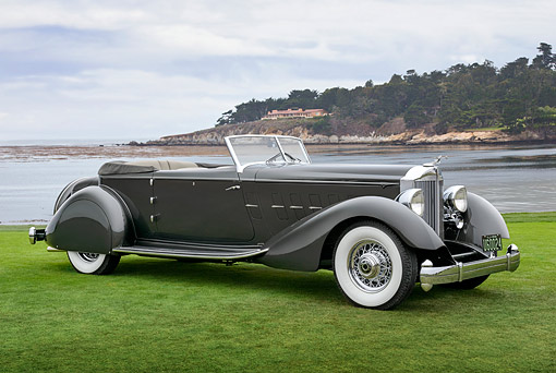 AUT 19 RK1122 01 © Kimball Stock 1934 Packard 1108 Twelve Dietrich Convertible Victoria Gray 3/4 Side View On Grass By Water Pebble Beach
