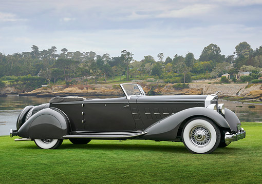 AUT 19 RK1124 01 © Kimball Stock 1934 Packard 1108 Twelve Dietrich Convertible Victoria Gray 3/4 Side View On Grass By Water Pebble Beach