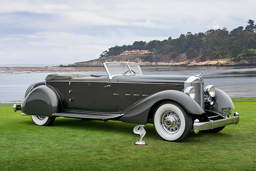 AUT 19 RK1125 01 © Kimball Stock 1934 Packard 1108 Twelve Dietrich Convertible Victoria Gray 3/4 Side View On Grass By Water Pebble Beach