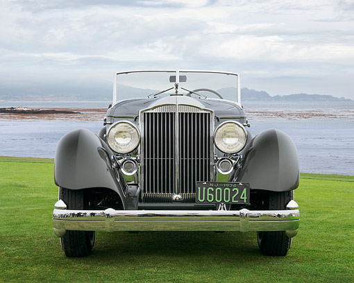 AUT 19 RK1129 01 © Kimball Stock 1934 Packard 1108 Twelve Dietrich Convertible Victoria Gray Front View On Grass By Water Pebble Beach