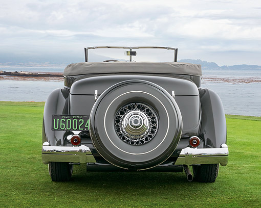 AUT 19 RK1130 01 © Kimball Stock 1934 Packard 1108 Twelve Dietrich Convertible Victoria Gray Rear View On Grass By Water Pebble Beach