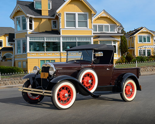 AUT 19 RK1131 01 © Kimball Stock 1930 Ford Model A Roadster Pickup Maroon 3/4 Side View On Pavement By House